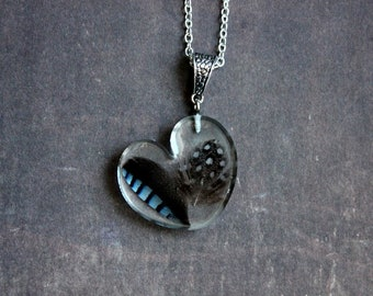 Necklace 62 cm + 2 feather inclusion and resin heart pendant