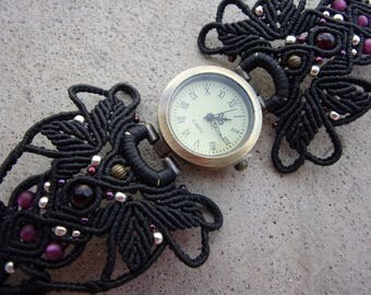 shown with black macrame bracelet, and purple