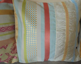 Pillow cover: turquoise, red, orange, yellow, lime green and ecru.