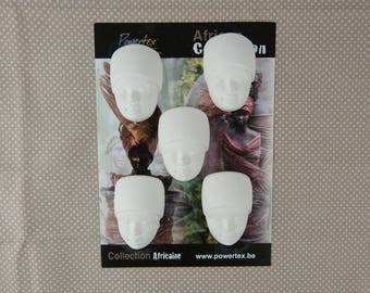 African women to decorate plaster heads