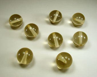Set of 8 synthetic beads, 20 mm, champagne, translucent.