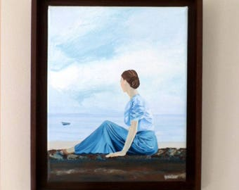 Table - The young lady sitting watching the sea