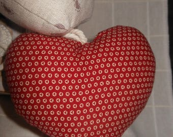 History of heart in red fabric with small white circles