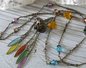 Long multicolored Bohemian glass beads and filigree with drops of resin ball