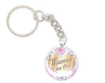 "a silver button ""mum in gold"" keychain"