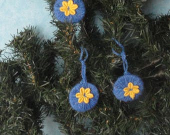 Set of three blue and yellow Christmas tree ornaments
