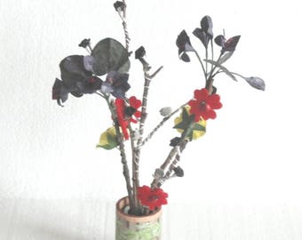 Bouquet of artificial flowers on branches of trees and vases to choose