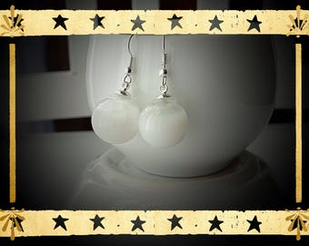 Opaque white liquid filled glass globe mounted on Stud Earrings