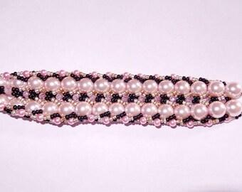 Pink, black and gold spiral bracelet