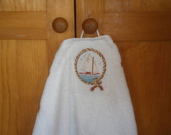 "Hand towel embroidered with ""My sailboat"" cross stitch"