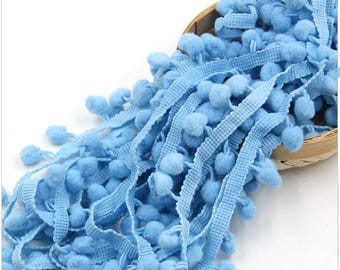 One meter of trim tassel color: sky blue