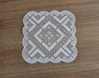 White tea towel made in the bobbin lace doily