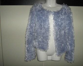 Vest for girl in shiny fluffy yarn