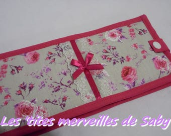 a horizontal opening floral checkbook