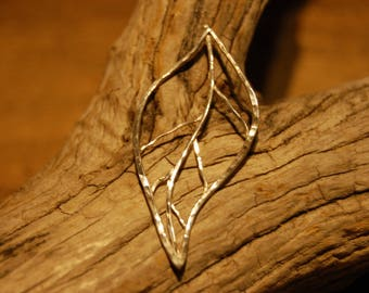 a sheet of sterling silver pendant jewelry