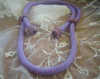 Purple necklace and 2 rhinestones