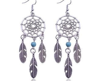 pair of silver and turquoise dreamcatcher earring
