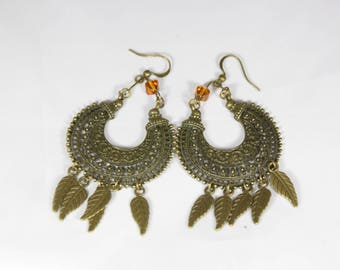 beautiful earrings with glass bead and bronze metal