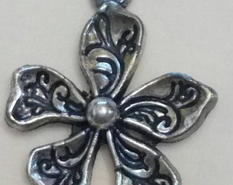 finely crafted carved flower metal charm