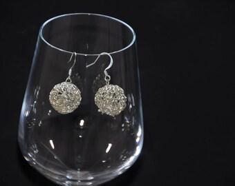 Dangling earrings, silver balls.