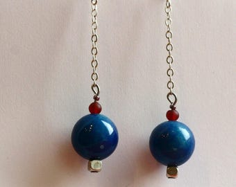 long dangle earrings and brilliant blue South Sea Pearl