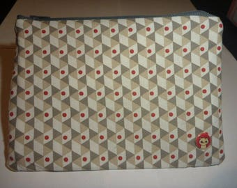 Kit has makeup beige red white geometric patterns