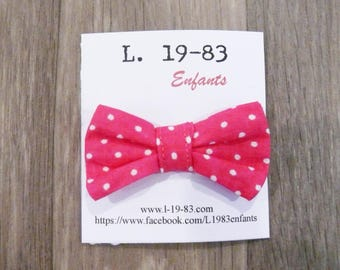 Bow shaped fuchsia hair clip