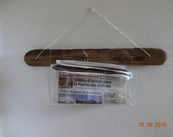 magazine in drift wood and plexiglass transparent