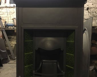 Antique cast iron tiled fireplace
