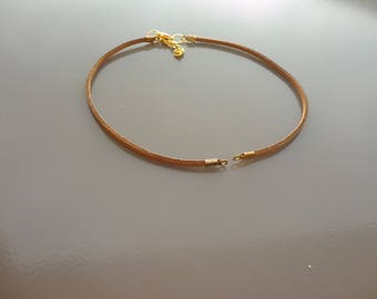 chocolate leather, suede cord on greenhouse Gold Ribbon necklace