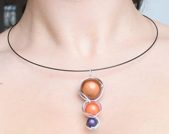 Crystal magic brown orange and plum and aluminum wire necklace pendant