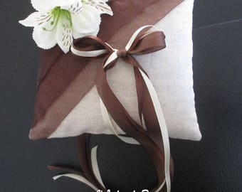 Pillow linen and organza chocolate and small orchids.