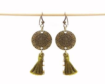 Ethnic earrings and khaki tassel