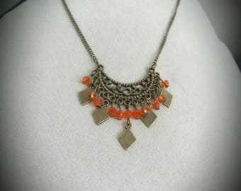 Bronze chandelier necklace orange facets