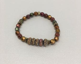 Amber, Gold, Copper, and Green beaded bracelet with amber gold accent pieces