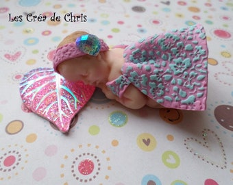 """baby girl with her decorated dress """"flower reliefs"""" polymer clay."""