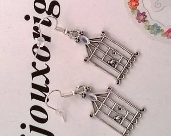 """Earrings with a """"bird cage"""" charm"""