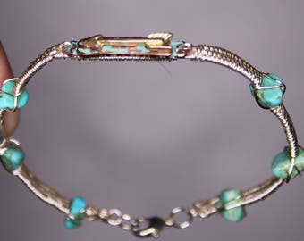 Silver wire wrapped bracelet with turquoise stones