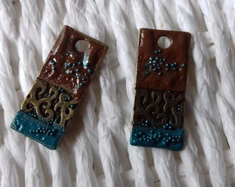 2 handcrafted enameled brass charms