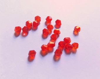 40 4mm transparent red glass bicone beads