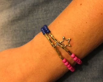 Cheerful double bracelet with gold bead