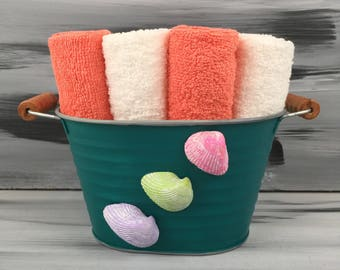Green Beach Bathroom Bin - Beach Bathroom - Bathroom Wash Cloth Holder with Seashells.  4 dark peach wash cloths and 4 white wash cloths.