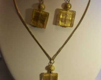 Set golden color, square glass beads.