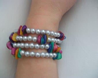 Multicolor cuff and grey pearls.