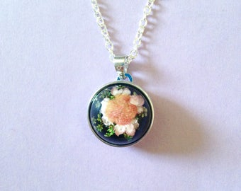 Necklace featuring a single dried black salmon flower cabochon