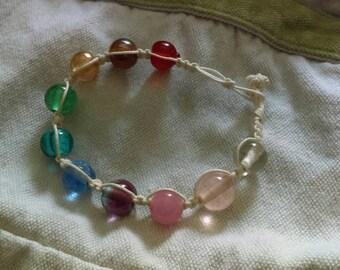 Rainbow-style beaded hemp bracelet