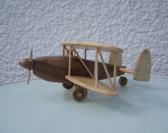 Miniature of a biplane airplane made of wood: walnut and Poplar.