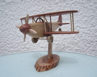Miniature of a biplane airplane made of wood: oak and Juniper.