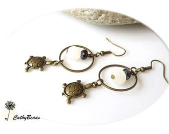 Bronze ring earrings and their turtle