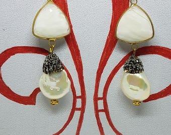 White and rhinestone earrings